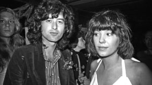 LOS ANGELES - JUNE 3: Led Zeppelin guitarist Jimmy Page arrives for an after party at Rodney's English disco accompanied by his girlfriend Miss Pamela (Pamela Des Barres) He will leave the party with the teenage Lori Maddox on June 3, 1973 in Los Angeles, California. (Photo by Richard Creamer/Michael Ochs Archives/Getty Images)